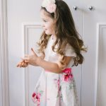 little girl wearing a floral party dress