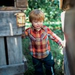 Little boy Boaz in his red plaid checked shirt and jeans