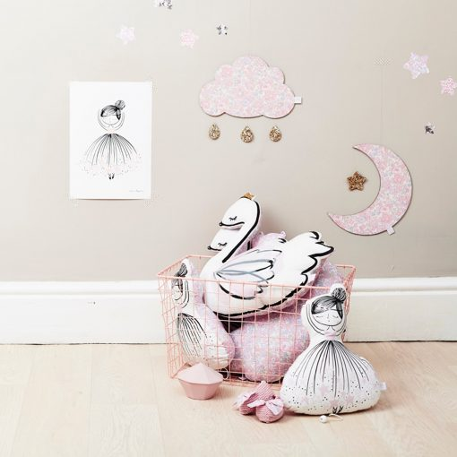 basket piled high with cushions in the shape of swans and ballerinas