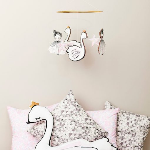 pretty pink girls bedroom with swan princess mobile and large cushion