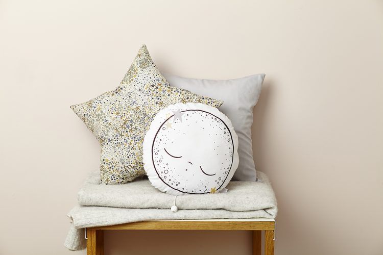 moon and star shaped cushions with liberty prints