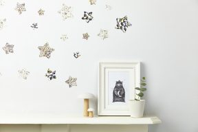 framed bear print with wall mounted stars in a liberty print