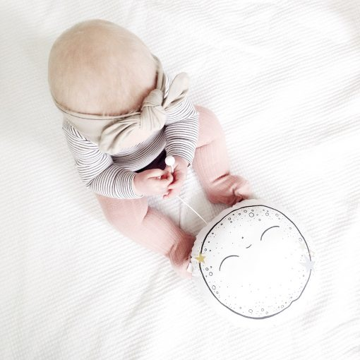 baby with her moon cushion by little cloud