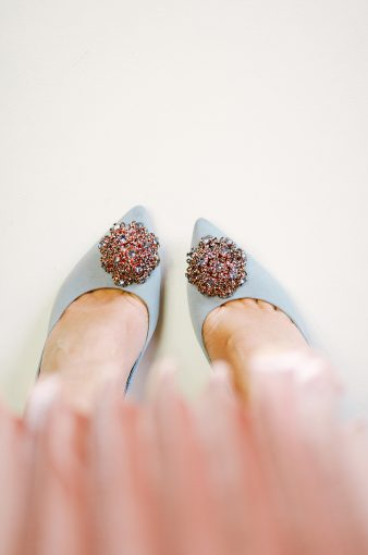 pretty feet wearing the blue peetch Ted Baker shoes paired with a pink silk pleated skirt