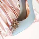 the Ted Baker Peetch shoe displayed on a pink silk pleated skirt