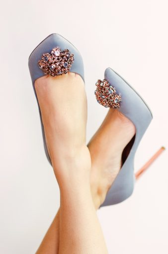 pretty feet in the air wearing the Ted Baker Peetch shoes in blue and rose gold