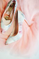 ted baker court shoes with floral print and rose gold insoles displayed on a pink tulle skirt