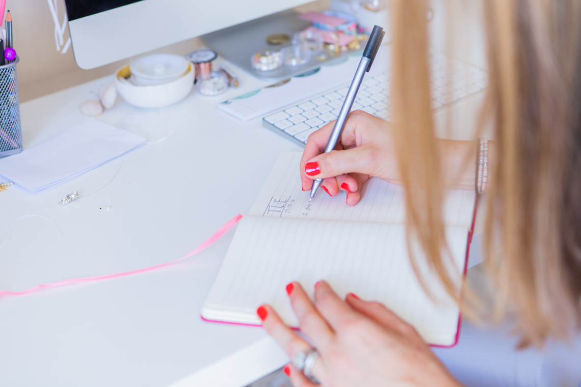 Victoria writing at her desk in her office