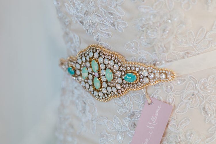 an intricate bridal sah with turquoise crystals and gold beading