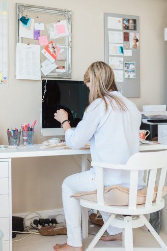 Victoria working at her office desk on a new design