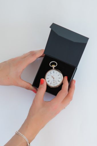 vinatge watch displayed in a black box and held by Victoria