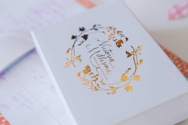 white box with gold foil logo as packaging