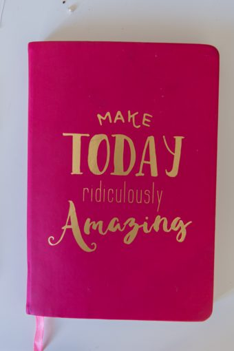 pink notebook which says make today ridiculously amazing