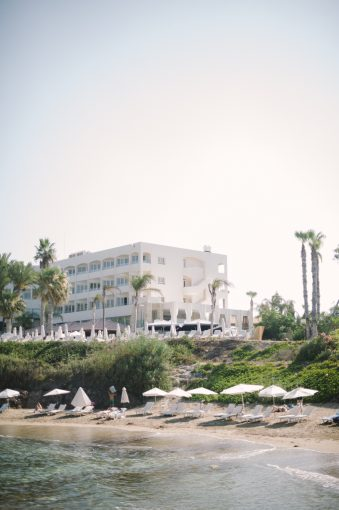 the beach and Alexander the Great Hotel