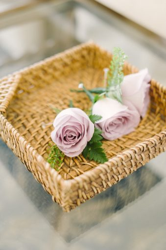 rose buttonholes on a tray