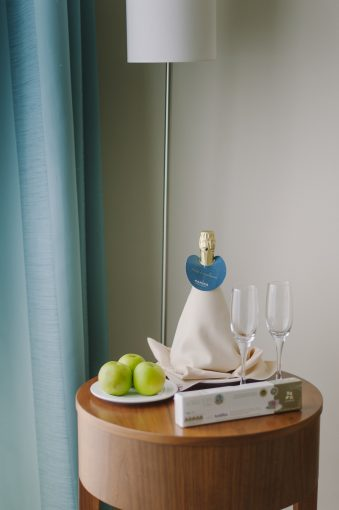 bedside table and welcome drinks at the Alexander the Great hotel