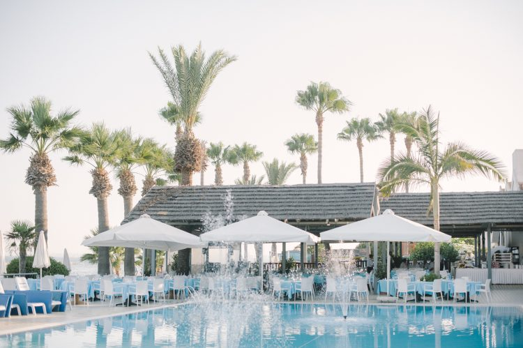 the pool area and pool bar at The Palm Beach Hotel & Bungalows