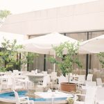 an outdoor courtyard and fountain aread at The Palm Beach Hotel & Bungalows