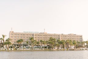 front of the The Palm Beach Hotel & Bungalows