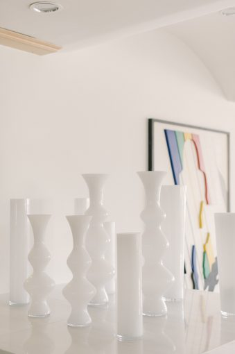 white gloss vases as part of the cool hotel decor