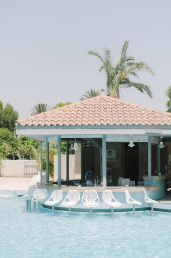 pool bar and stools at the The Palm Beach Hotel & Bungalows
