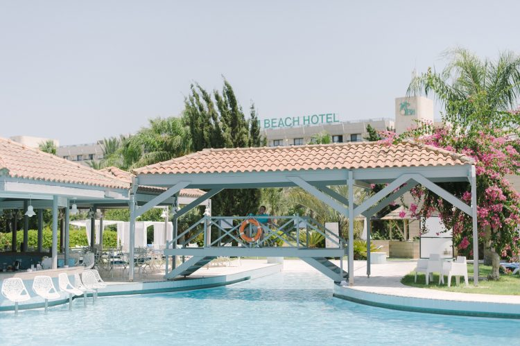 bridge over the pools at The Palm Beach Hotel & Bungalows