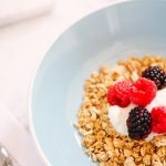 blue bowl of granola and berries