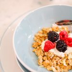 blue ceral bowl with granola and berries