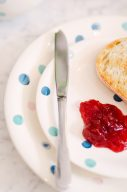 white plates with blue spot pattern design with fresh toast and jam