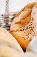 fresh golden loaf of bread with sunflower seeds