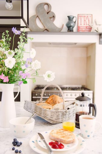 delicious breakfast setting with coffee fresh bread basket and orange juice