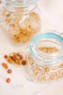 clear jar with blue trim containing nuts
