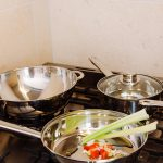 silver pan with celery tomatoes and onions cooking