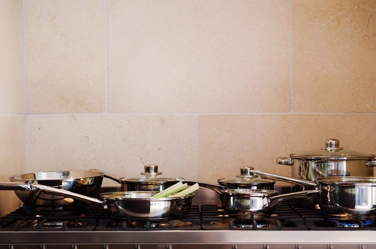 stove top with collection of stylish cooking pans