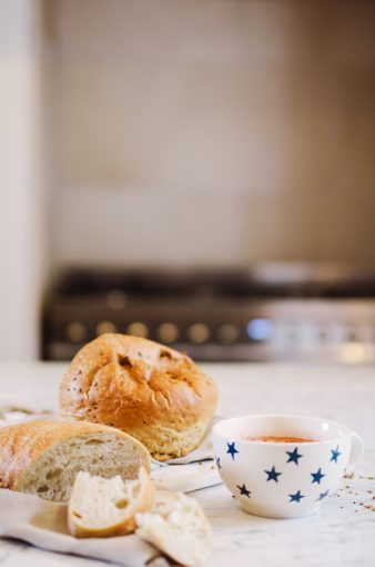 stylsih kitchen with large cup of hot chocolate in star print and fresh breads