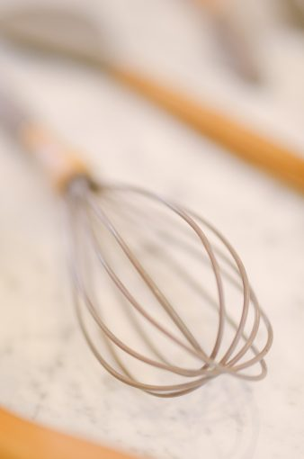 whisk with a wooden handle