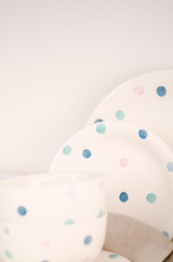 white and blue spotted dinnerware