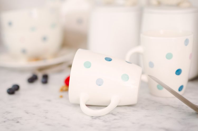 white cup with blue spots printed