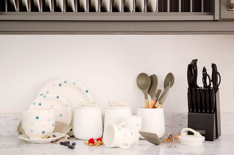 stylish collection of kitchen ware on a marble counter top