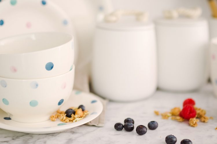 spotty blue dinnerware and blueberries spilled
