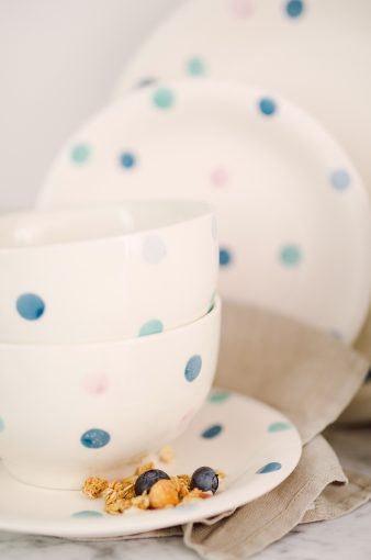 collection of white dinnerware with blue spotty design