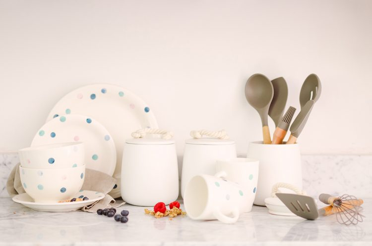 kitchen collection with dinnerware coffee jars and cooking utensils
