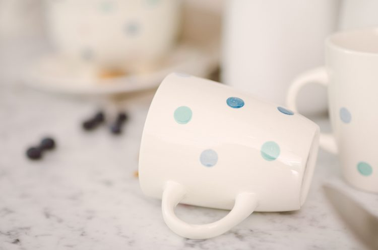 cute white mug with blue spot pritn design
