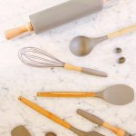collection of kitchen utencils on a marble top