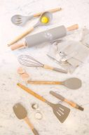 kitchen utensils for baking and flour spilling over the marble top