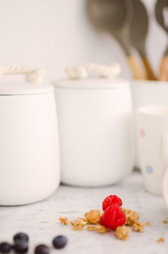 white kitchen storage jars with rope handles