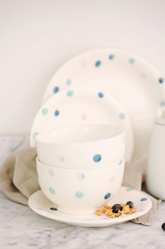 stack of cute dinnerware collection with blue spot pattern