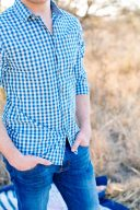 details of Olivers outfit with a blue and white checked shirt and denim jeans