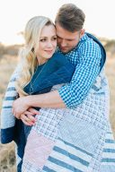 couple wrapped together in a patchwork blanket