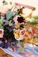details of flowers with autumnal leaves and roses